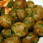 new potatoes, sauteed with butter, parsley and spring onions